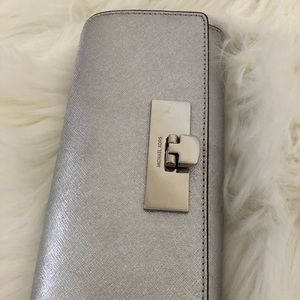 Classy leather Michael Kors clutch for night out